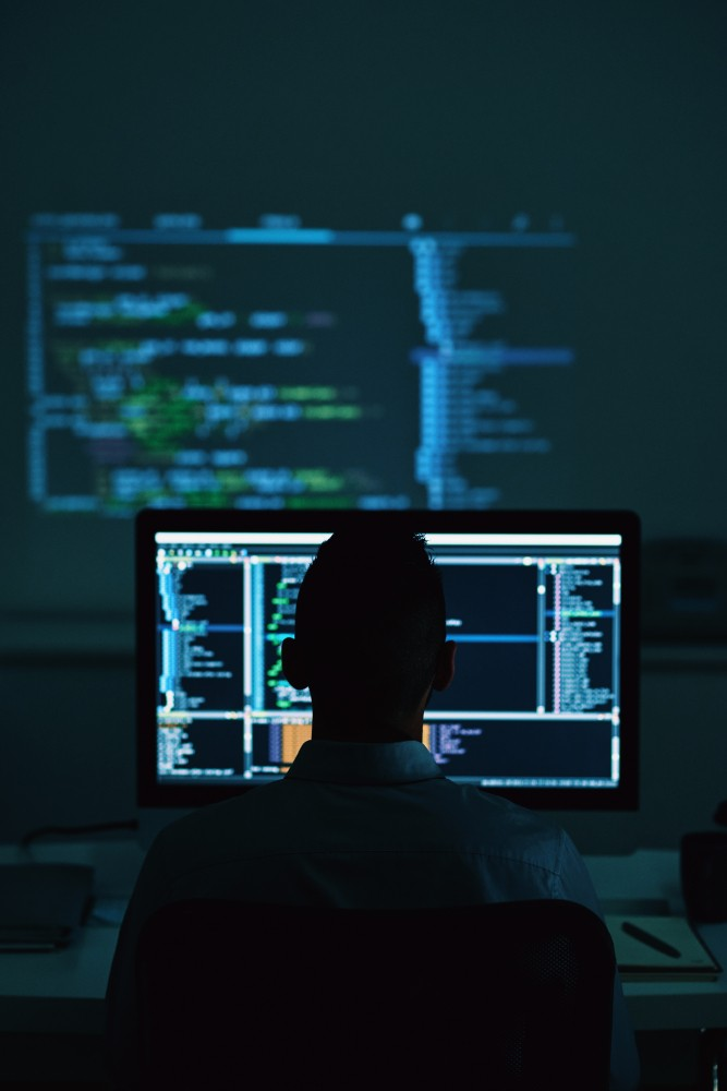 Software,Developer,Working,In,Office,Late,At,Night