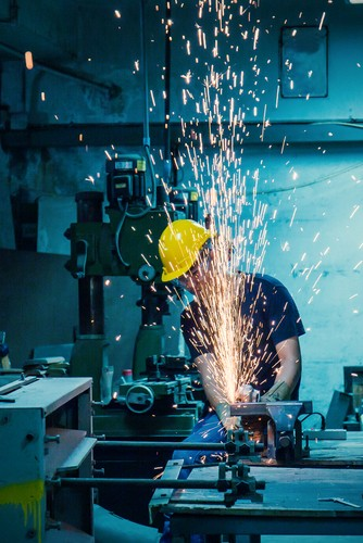 Heavy,Industry,Manual,Worker,With,Grinder,Background,,Asian,Man,Wearing